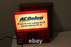 Vintage Chevrolet key holder & AC DELCO Radio nos